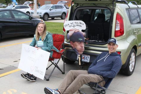 The senior parade will be an event this year in which teacher line up in the parking lot with signs and fun poster like Brittany Sharitz, librarian, and Kevin Sharitz, technology teacher, did last year.