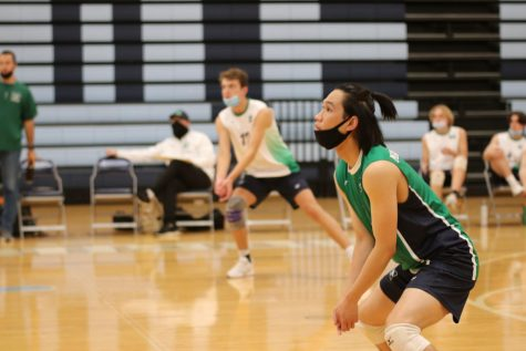 Senior Marco Fernandez, varsity libero, prepares to pass the ball in the game against Parkway West on Monday, May 10. MHS ended up losing to the Longhorns 3 games to 1.