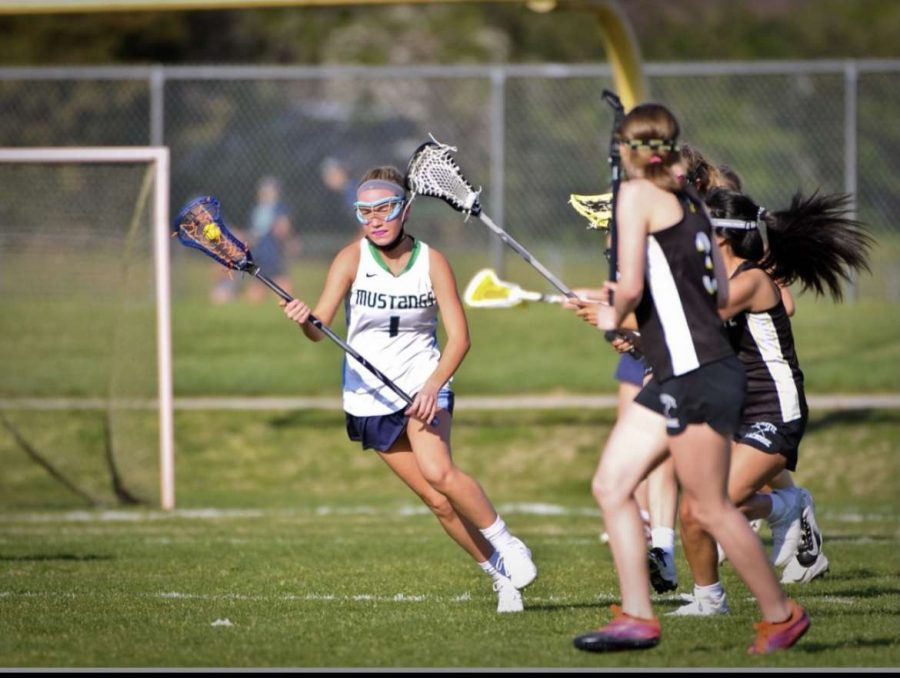 Claire Montgomery, sophomore, plays midfielder against Lafayette High School Monday, April 5. The game ended 7-4 with LHS taking the win.
