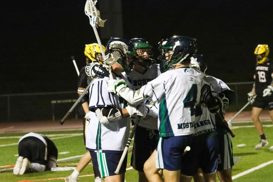 The Mustangs celebrate after midfielder Patrick Kirwan, senior, scores the game winning goal with 6 seconds left in the game. The Mustangs will face off against the Lindbergh Flyers at 7 p.m. on Friday May 21.