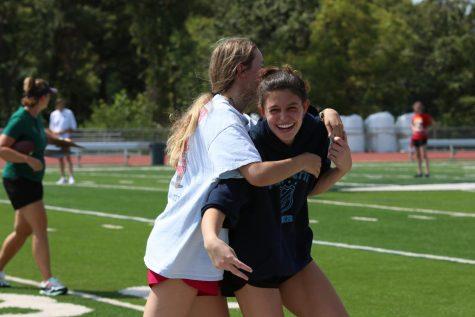 Seniors Taylor Donatelli and Adeline Leonard embrace each other during Powderpuff practice enjoying their senior year.