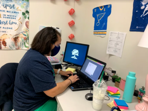 Megan Fink, language arts teacher, creates assignments through Canvas for her language arts students who are fully virtual.
