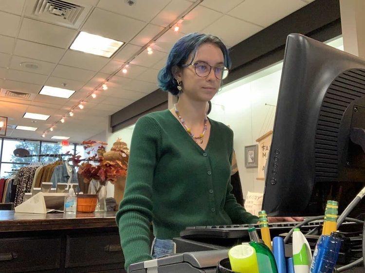 Senior Sydney Rehling sets up her register for her five hour shift at Pure by Jen.