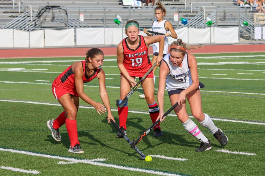 """Captain Kenzie Petch, senior, dribbles through two Pioneer defenders to make a break for the goal. Petch has committed to play at Maryville University, an NCAA Division II school, next year. """"I've had my friends support, family's support, and a big part of it was my effort,"""" she said."""